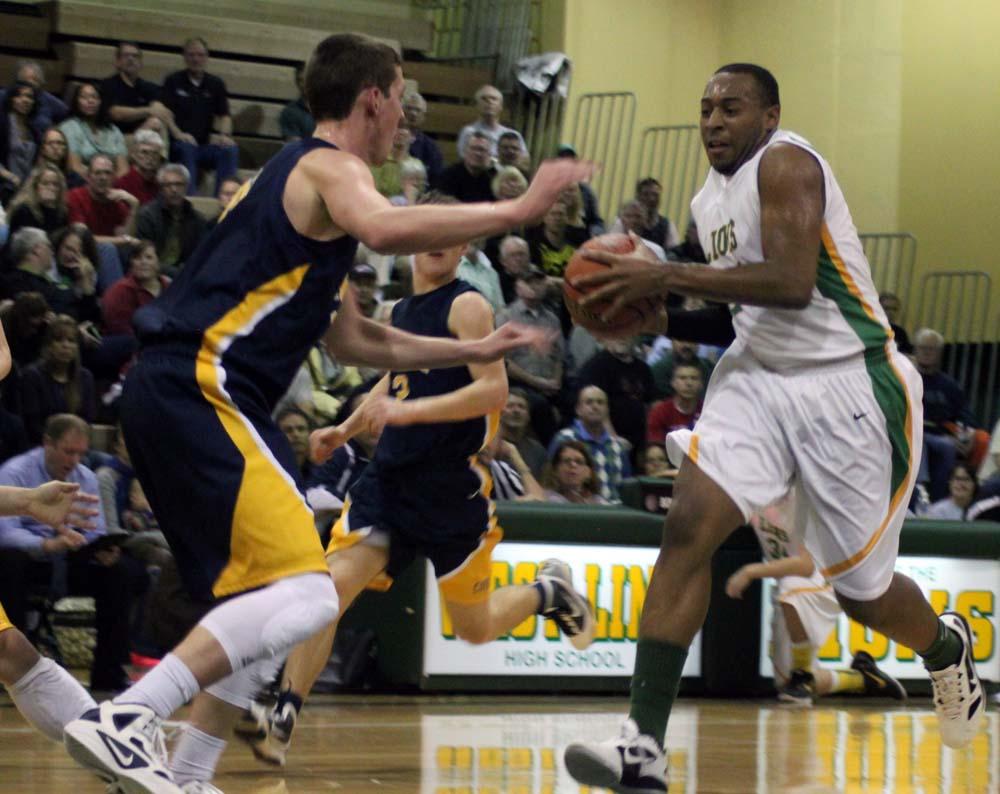 West Linn boys basketball powers past Cougars en route to league title