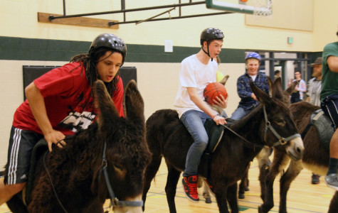 Teachers, students, cops ride donkeys to raise leadership funds