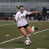 #19 senior Leah Olsen, goes for the kick in their game against Glencoe. Finishing their first round of playoffs with a victory of 1-0.