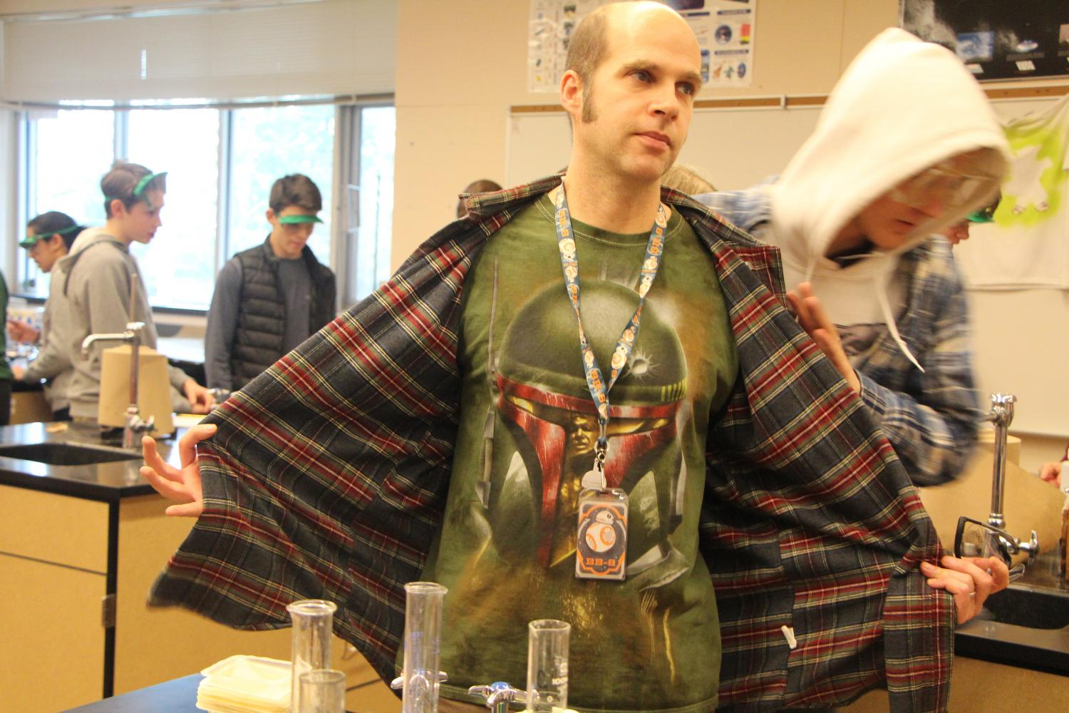 Showing+off+his+Star+Wars+Shirt.+Steve+Davala+has+a+passion+for+his+students%2C+Chemistry+and+science+fiction.