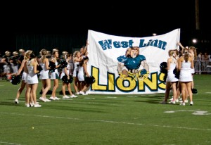 Lions open league play against 1-2 Canby