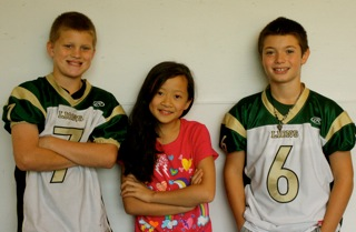 Justin Hoover, Maddie Khamphilavong, and Brodie Corrigan, fifth graders.
