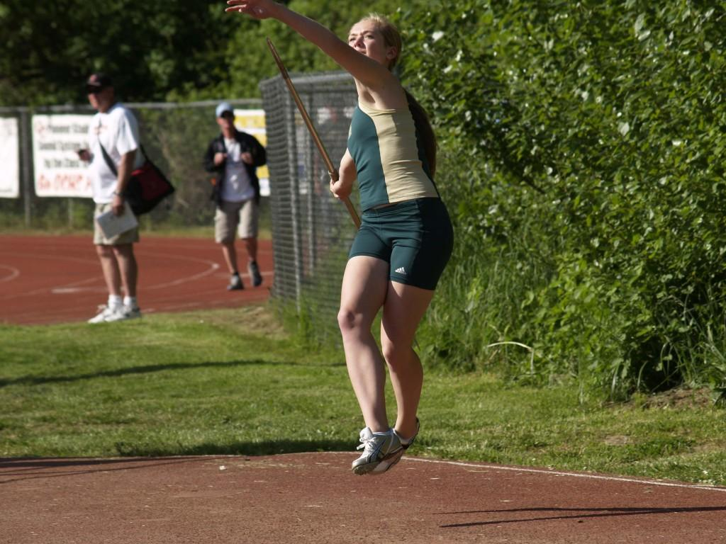 Maria Green, senior, throws javelin in the disctric tournament at Oregon City. Her throw of 110 ft earned her a place at the State Championshps, where she placed seventh.