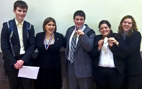 Speech and debate sweeps district tournament, headed to state