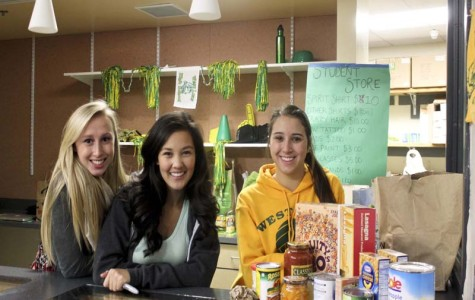 ASB students collecting canned good at the student store in WLHS. West Linn strides to help out the community and families in need, our major fundraiser is the annual canned food drive held at WLHS.
