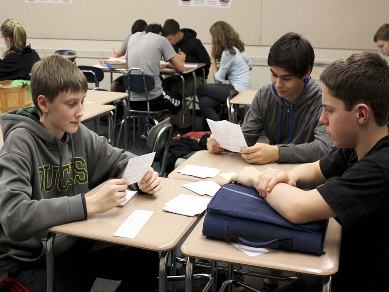 (From left): Jake Oswald, Neil Yotsuya and Zachary Knight, freshmen, study biology concepts.  They were receiving study help in preparation for finals as a part the COCOA and CRAM event.