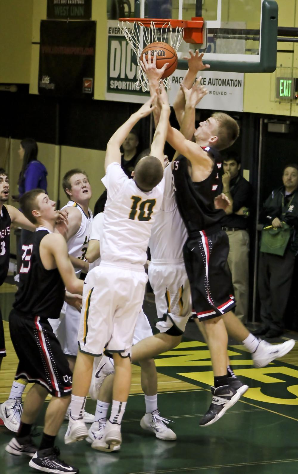 West Linn Basketball clean sweeps Oregon City at home