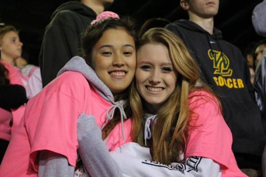Emily+Gibson+and+Hannah+Morford%2C+seniors%2C+display+their+student+spirit+and+sport+the+color+pink+during+last+week%E2%80%99s+game+against+Canby.+During+the+game%2C+students+were+decked+out+in+pink+shirts%2C+pink+paw+prints+and+other+pink+items+to+support+Breast+Cancer+Awareness.+Throughout+the+month+of+October%2C+WLHS+was+engaged+in+a+campaign+to+raise+awareness+and+funds+for+research.
