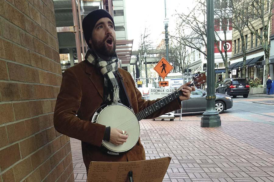 John+Ott%2C+street+performer%2C+hopes+to+return+home+to+Kentucky+for+the+holidays+by+collecting+spare+change+from+Portland+citizens.+Ott%27s+parents+and+siblings+are+excited+for+him+to+return+after+not+seeing+him+since+he+moved+to+Portland+almost+four+years+ago.