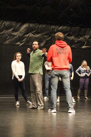 """Deanna Plunkett, sophomore, Steven Beckingham, director, and Kyle Fulton, junior rehearse stage fighting in the Black Box for the modern twist """"Julius Caesar"""" production. The reworked play showcases talents of many female actors taking on classicly male roles for the new and reinvigorated take on """"Julius Caesar."""""""