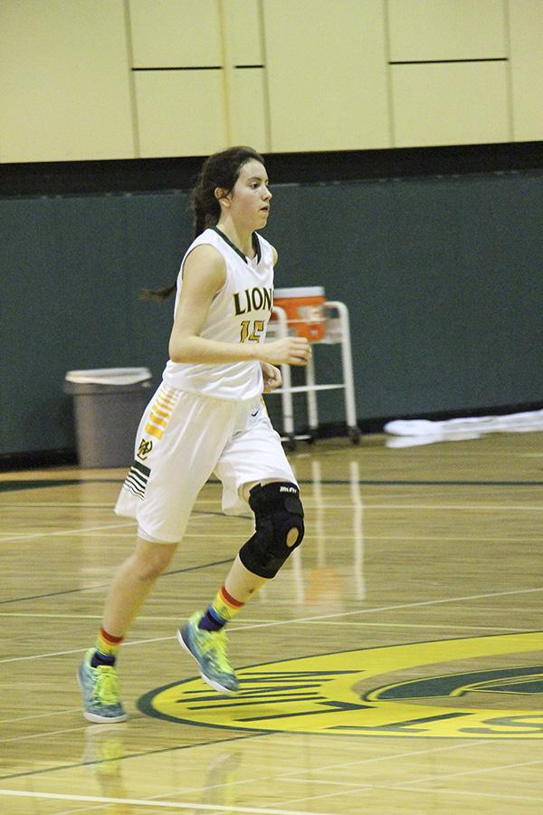 Taylor, senior, plays forward  for the West Linn Lions. She scored ten points against Tigard leading the lions to a 45-35 win.