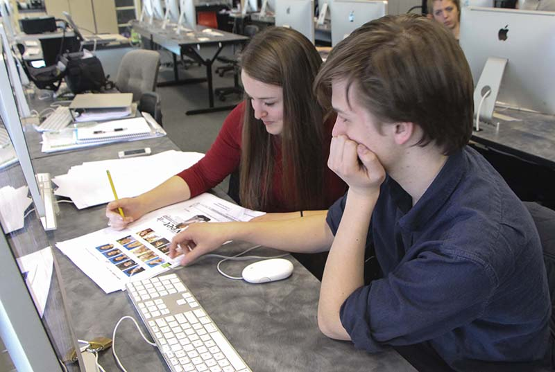 Jack Draney and Jillian Emken, juniors, Green & Gold editors-in-chief, work on proofs for the 2014-2015 yearbook. Last year the book won an All-American award and the staff is looking to do the same again this year.