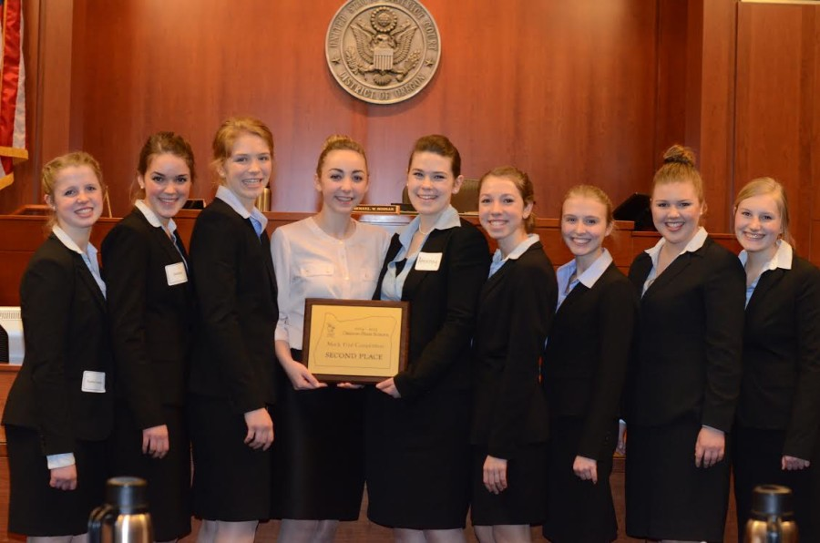 Junior Mock Trial Team members, Hannah Archuleta, Kira Duff, Emma Hansen, Emily Karabeika, Cira Kelly, Kendra Ogden, Leah Olson and Elizabeth Torralba receive their award after claiming second place at State. The Mock Trial season is over, but they will resume practice for Empires in August.