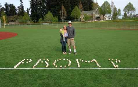 Last year, Rudy Hughes, junior, asks Mackenzie Hartdegen, senior, to prom. He laid out baseballs to spell out 'prom?' because of his love for baseball.