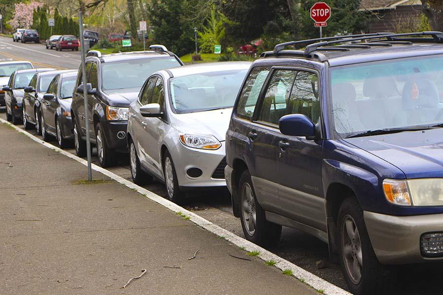 "Some students arrive an hour and a half early almost every day, in order to find a parking spot on the street. Pictured here cars are lined up along West ""A"" Street, in front of WLHS."