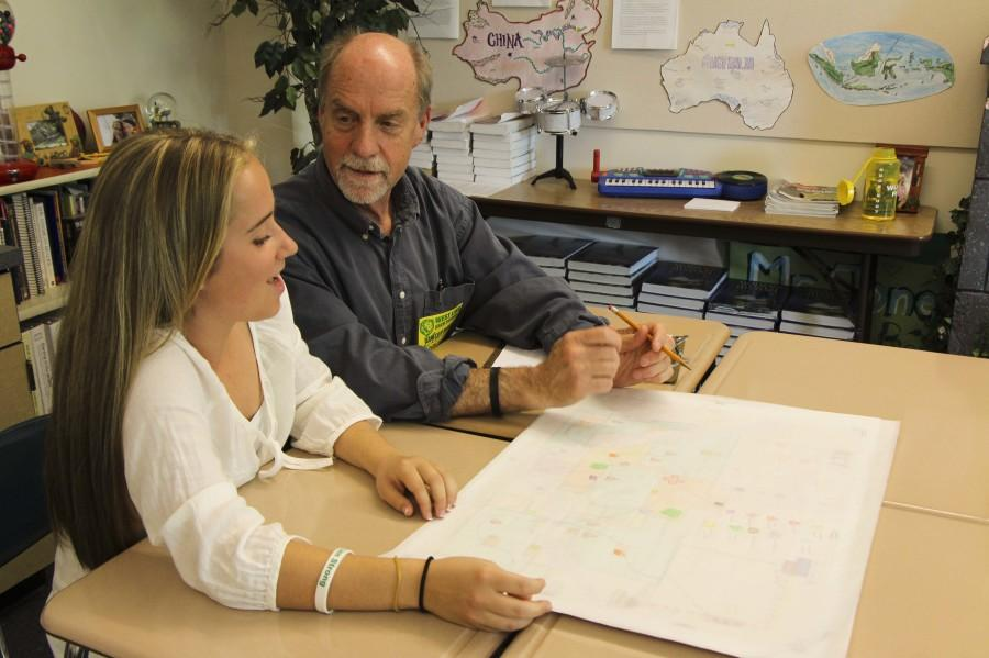 Lydia Van Winkle, Junior, talks with West Linn's incoming mayor. He paid a visit Todd Jones' second period AP Government class to advise students on city planning concepts.