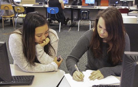Hailey Kim, junior, and Gabrielle Elrod, senior, begin preparing for final exams. Finals will be held June 10-12, beginning with periods 5 and 6. All of these days will be half days.