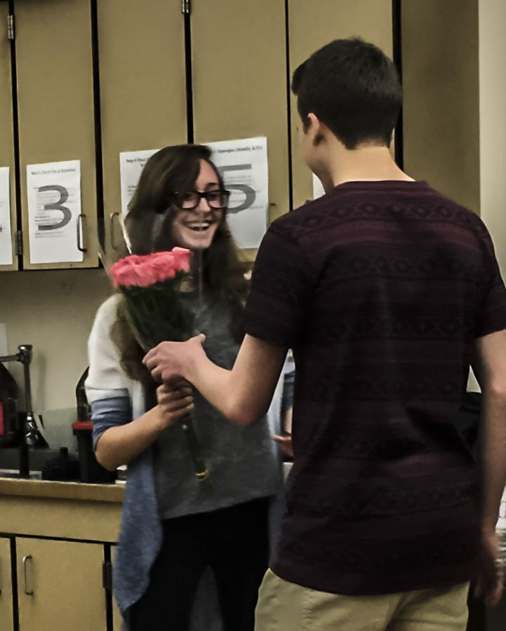 "WLHS boys think of creative ways to ask girls to prom; Kevin Galloway, junior, asks Natalie McMillan, sophomore, in her Photo 1 class by having her develope photos that spell out ""prom."" Prom is scheduled for May 16 at the Oregon Zoo from 8-11. Tickets go on sale next week and are $40."