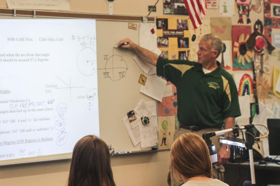 Steve Schramm, math teacher, instructs his second period Advanced Algebra class.  Schramm will be transferring to Wilsonville High School this fall in order to be closer to his family.