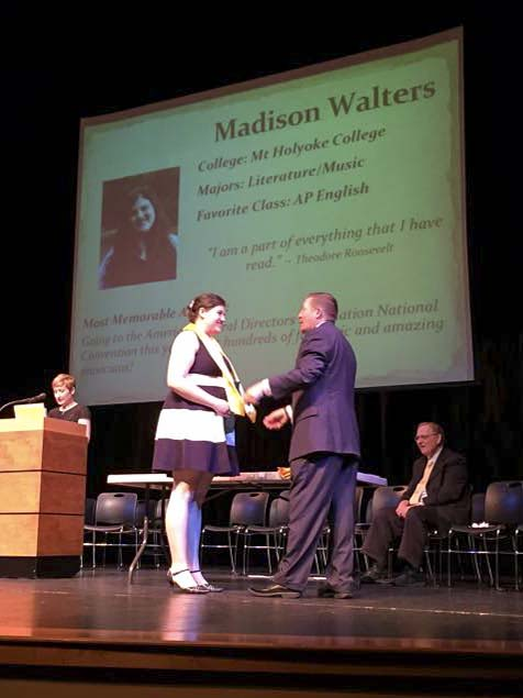 Madison Walters, Class of 2015, receives her honor stole from Lou Bailey, Principal, at the Evening of Excellence which was Thursday, May 28 at 6:30 p.m. in the Performing Arts Center. Graduation took place at the University of Portland Chiles Center.