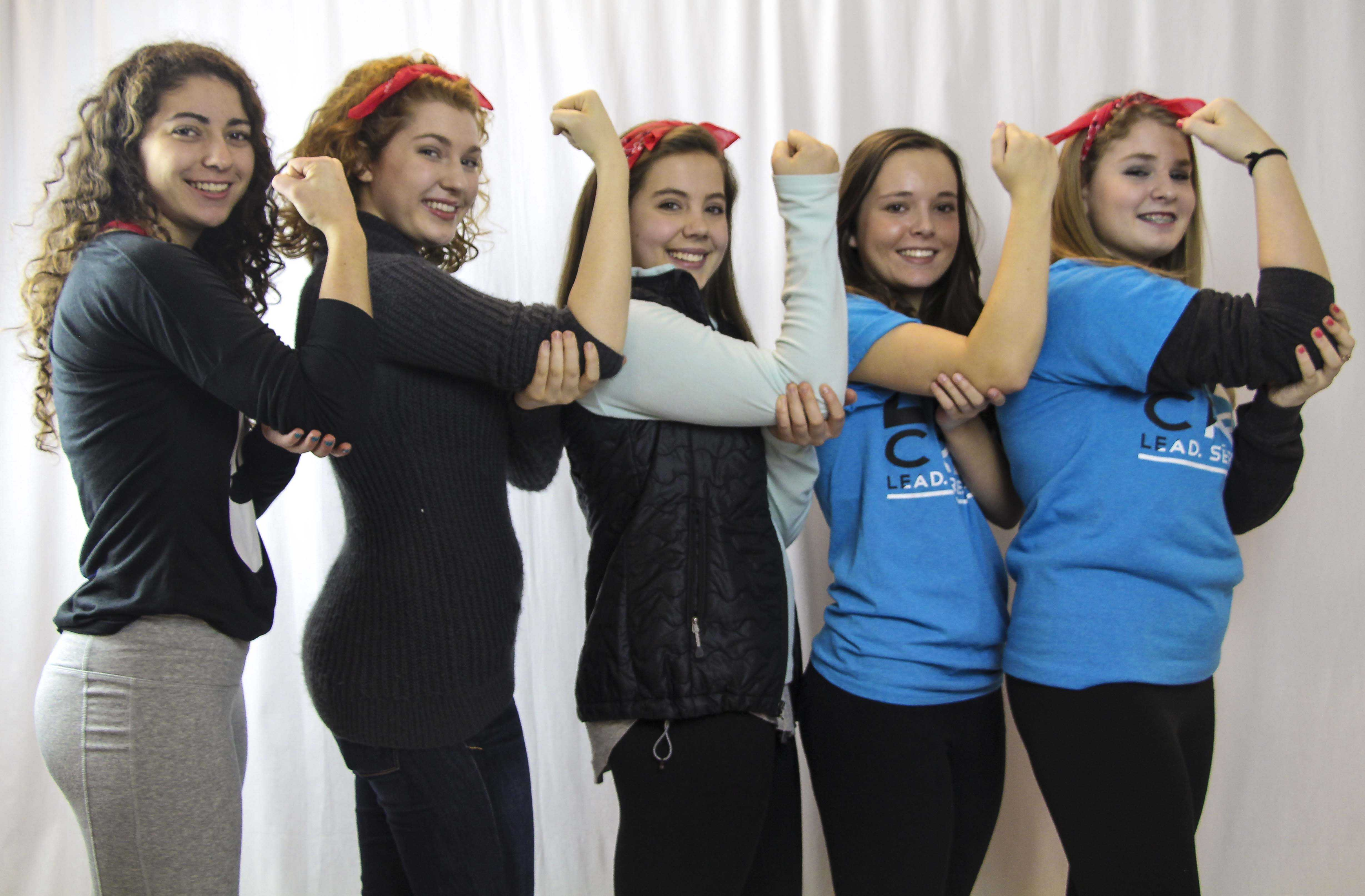 Feminists at WLHS practice their best Rosie the Riveter pose. The new Feminism Club will commence in fall of 2015 to talk about feminist issues as well as contribute to the community.