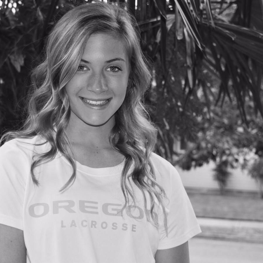Morgan Finklea, sophomore,  shows off her University Of Oregon  shirt after recently committing to the Duck's lacrosse program. Finklea, is on the Varsity lacrosse team and was part of the state championship team.