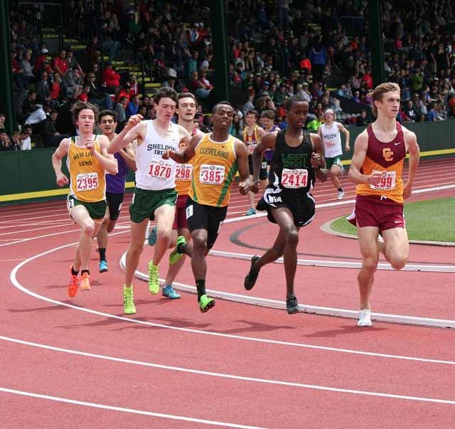 Roman Ollar (far left), competes in the 1,500 meter race on May 23. Ollar placed third overall behind Jackson Mestler of Sheldon High School and Roba Sultessa of Cleveland High School