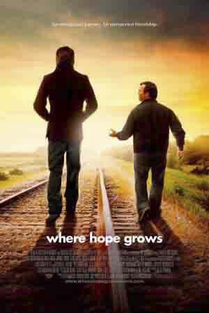"Calvin Campbell, played by Kristoffer Polaha and Produce, played by David Desanctis  walk down the train tracks in the faith-based drama ""Where Hope Grows.""  Although the film only brought in $1 million in gross sales, it still is a must see."