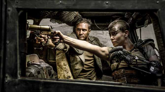 Furiosa+%28Charlize+Theron%29+and+Max+%28Tom+Hardy%29%2C+fire+their+weapons+at+incoming+War+Boys+in+their+new+film+Mad+Max%3A+Fury+Road.