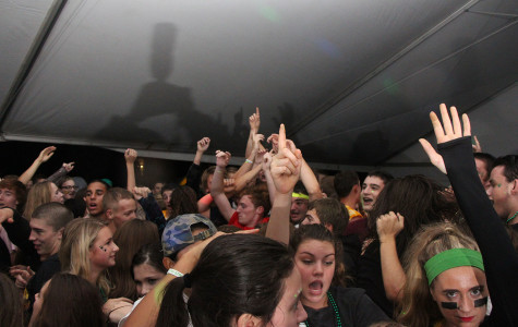 "Students enjoy last year's homecoming dance under the large white tent on the baseball field. Homecoming is on Oct. 23 and the dance will be held after the football game. ""Students can expect homecoming to be fun, loud, and exciting,"" Kylie Fretwell, Sophomore Class Director, Assistant to Public Relations and Assistant to Spirit Squad, said."