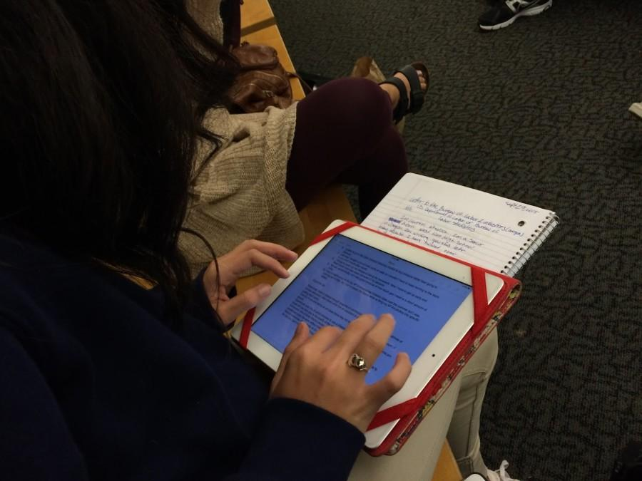 Lauren Wheelock, senior, writes and types her homework for Economics during passing time. Wheelock prefers typing but is open to expressing her ideas through her handwriting the assignment.