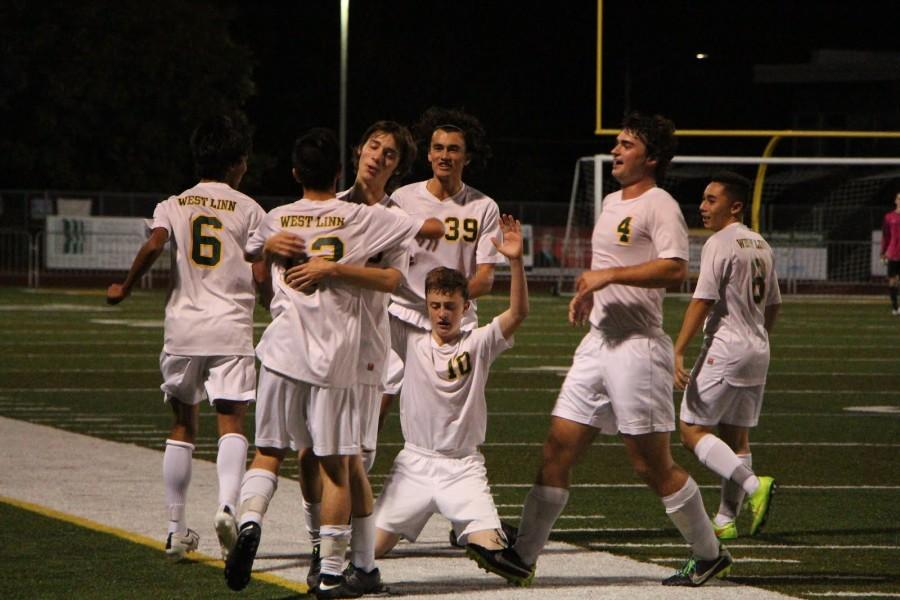West Linn Boys Soccer team celebrates their 5-1 victory over Tualatin. They are currently 1-0-1 in the Three River League and 4-2-3 overall.
