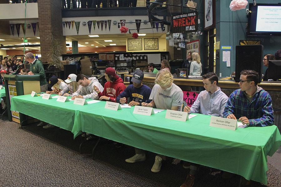 Eleven senior athletes signed their letters of intent on Nov. 12, National Signing Day.