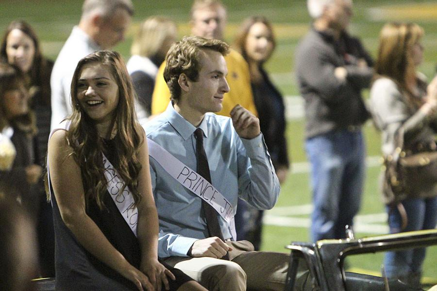 """Joining the Homecoming court on the field, Jeno Bean, 12, and Kokanee Ellingson, 12, were announced King and Queen at halftime. Bean said, """"I wasn't expecting to get nominated, but after I was I realized pretty fast that I was going to win, especially when I heard the 'Jeno' chant before we walked out. I'm glad that I had this experience. It was incredible."""" During the game, the Lions secured their No.2 position in the Three Rivers League with a 49-35 win over Tualatin during their Homecoming game on Oct. 23."""