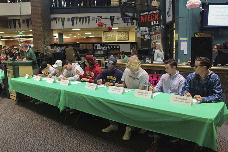 Lions+sign+their+letter+of+intent+to+continue+their+athletic+careers+at+the+collegiate+level.+Student-Athletes+will+be+heading+to+schools+all+around+the+country+next+year.+