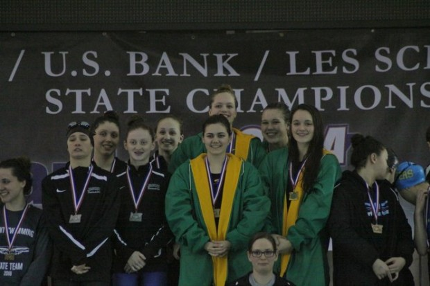 After+winning+the+200+medley+relay%2C+Pinger%2C+Laderoute%2CNorris+and+Laderoute+stand+on+the+podium+with+their+first+place+medals+at+the+6A+OSAA+State+Swimming+Championships.+Not+only+did+the+group+place+first+overall%2C+they+also+broke+the+state+record+for+the+event.+