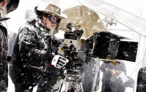 Quentin Tarantino (right) and Director of Photography Robert Richardson (left) are seen framing up a shot in the cold. The cameras and lenses used in the production had not been used for almost fifty years and had to be restored back to working order to be used in the film. The 65mm cameras allow for the film to be seen in special 70mm roadshow showings in 100 venues across 44 different cities.