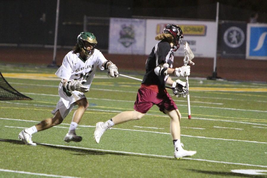 Boys+lacrosse+comes+back+from+a+loss+last+Monday+against+Beaverton+and+defeats+Tualatin+16-2+on+Apr.+8.