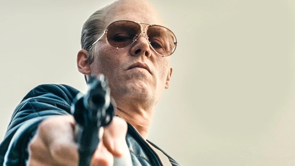 """Johnny Depp takes a promotional picture as his crime lord character James """"Whitey"""" Bulger. Achieving good scores across the board, this harkening back to the classic gangster movies of the past hit theaters on Sept. 18 2015. The dark and character driven film easily kept watchers engaged for its two hour and two minute running time."""