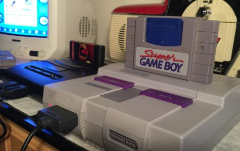 A Super Nintendo console with Super Game Boy player which allows you to play Game Boy games on the Super Nintendo