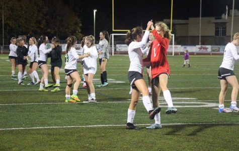 Despite  0-1 loss to Sherwood, Varsity girls soccer boosts spirits with  dance performed for the seniors after their final home game.