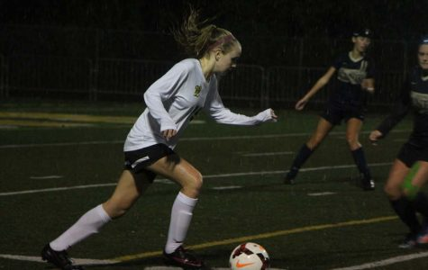 Pushing the ball forward, Abigail Schmidt, 9, sprints through the pouring rain. Girls soccer played Canby this Tuesday in the pouring rain. Leaving with a victory of 2-0.