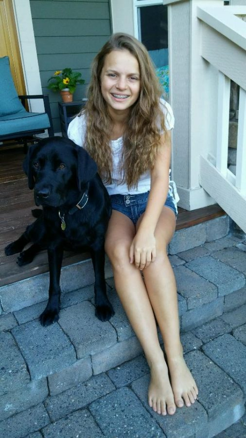 Instead of spending her spare time watching movies and going shopping, Hannah Burk, sophomore, trains guide dogs. She has worked with Guide Dogs for the Blind for the past four and a half years and plans to continue with her work for the next two and a half years. Photo courtesy of Hannah Burk.