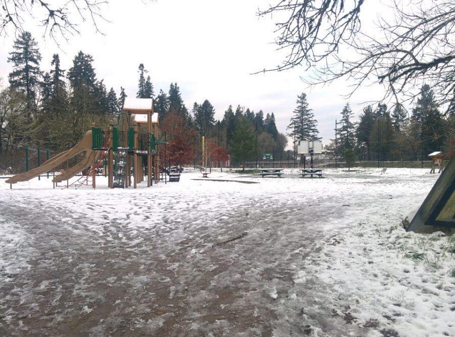 Snow-covered playground near Fields Bridge Park