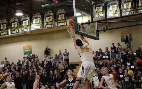 Khalid Thomas, senior forward, finishes with authority in a 88-44 win against Canby.