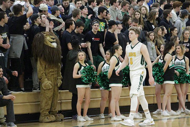 Braden Olsen, senior guard, walks in front of energetic student section in a 76-65 win against Lincoln.