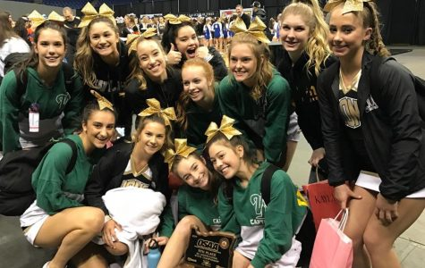 Varsity sports a fifth place trophy after competing at the State Cheer Competition.