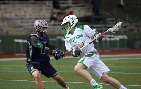 Dodging from the top of the box Elijah Gaunt, senior midfielder, shakes defender in 13-5 win over Mountain View.