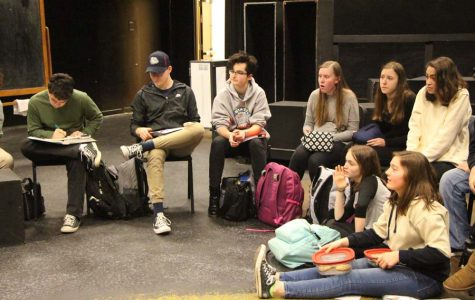 """The school's thespian troupe meeting during lunch while discussing future productions, the state thespian competition and the responses to their regular questionnaires. Both Linda Snyder, senior, and Deanna Plunkett, senior, were able to answer questions regarding future events involving the arts, along with discussing interesting plays or other artistic forms they urge other students to see. """"Both Deanna and I run meetings every Thursday and organize all events happening in the department."""" Linda Snyder, senior, said."""