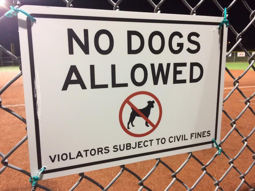 A warning posted to sports fans that dogs are not allowed in certain athletic areas around West Linn. In Eugene, Ore., a ban has been put in place increasing the repercussions of having a dog in their downtown area.